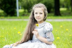 Sweet girl holding single flower Royalty Free Stock Images
