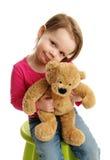 Sweet girl holding a teddy bear stock photo