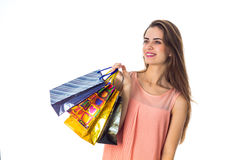 Sweet girl keeps packages with purchases in hand isolated on white background Royalty Free Stock Photo