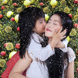 Sweet girl kiss her mother in xmas day Stock Photos