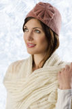 Sweet girl looking up. Cute sweet girl with white scarf and a pink winter cap looking up and smiling Stock Images