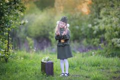 Sweet girl in a military uniform stock images