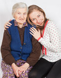 The sweet girl and the old woman staying together Stock Photo