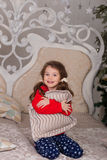 Sweet girl in pajamas getting ready for bed. The child indulges in bed before going to sleep Royalty Free Stock Photo