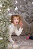 Sweet girl in pajamas getting ready for bed. The child indulges in bed before going to sleep Royalty Free Stock Photography