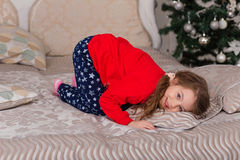 Sweet girl in pajamas getting ready for bed Stock Photography