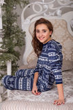 Sweet girl in pajamas getting ready for bed. The girl indulges in bed before going to sleep Stock Images