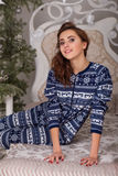 Sweet girl in pajamas getting ready for bed. The girl indulges in bed before going to sleep Stock Photo
