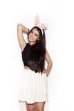 Sweet girl in pink bunny ears having fun on white background Stock Photography