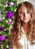 Sweet girl portrait near Christmas tree Stock Images