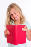 Sweet girl with red book in front of white background Stock Photography