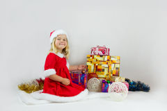 Sweet girl in a red Christmas costume Stock Photos