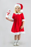 Sweet girl in a red Christmas costume Stock Photography