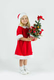 Sweet girl in a red Christmas costume Royalty Free Stock Images