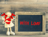 Sweet girl with Red Heart. Holidays decoration. Blackboard Stock Photo