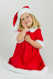 Sweet girl in a red new year cap Royalty Free Stock Photo