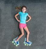 Sweet girl in roller skates painted with chalk stock photos