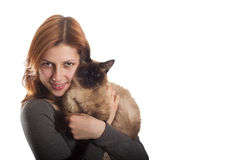 Sweet girl with a Siamese cat. On a white background isolated Royalty Free Stock Photos