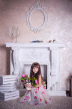 Sweet girl sitting with a bunch of flowers Royalty Free Stock Photo