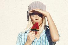 Sweet girl sucking lollipop Stock Photos