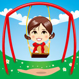 Sweet Girl Swinging Stock Image