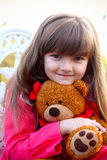 Sweet girl with a teddy bear Stock Photos