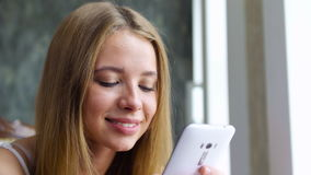 Sweet girl typing message on smartphone stock video