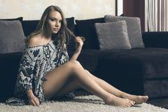 Sweet girl , on white carpet Royalty Free Stock Images