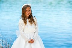 Sweet girl in white communion dress. Stock Photography