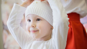 Sweet girl in a white knitted cap Royalty Free Stock Photography
