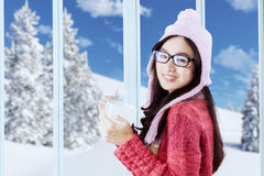 Sweet girl in winter clothes holding hot coffee Stock Photography