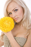 Sweet Girl With A Beautiful Yellow Flower In Royalty Free Stock Image