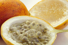 Sweet granadilla fruit. Whole and cut granadilla fruit isolated on white Royalty Free Stock Images
