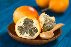 Sweet Granadilla or Grenadia. (lat. Passiflora ligularis) fruit cut in half,  of which the seeds and the surrounding juicy pulp is eaten or is used to prepare Royalty Free Stock Images