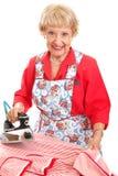 Sweet Grandma Ironing Stock Photography