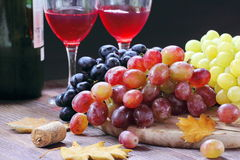 Sweet grape of different kinds and red wine Royalty Free Stock Photos