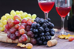 Sweet grape of different kinds and red wine Stock Photography