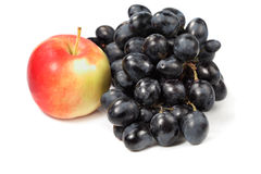 Sweet grape and red apple royalty free stock images