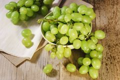 Sweet grapes on a bowl on a wooden background Royalty Free Stock Image
