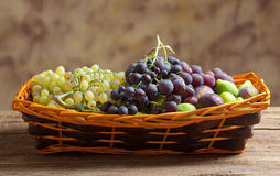 Sweet grapes and figs. In basket Stock Image