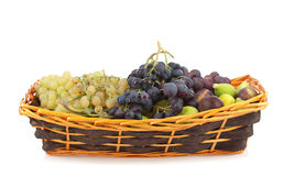 Sweet grapes and figs. In basket Royalty Free Stock Images