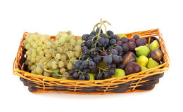 Sweet grapes and figs. In basket Royalty Free Stock Photos