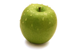 Sweet green apple with water drops Stock Photography