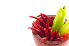 Sweet green chili and red hot chili. In wooden mortar Royalty Free Stock Photography