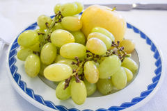 Sweet green grapes and apple Royalty Free Stock Photo