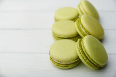 Sweet green macaroons on wooden table Stock Photo