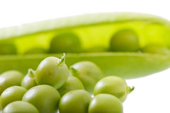 Sweet green peas. Sweet green peas isolated on white background Royalty Free Stock Photos