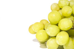 Sweet green seedless grapes isolated on white back Royalty Free Stock Images