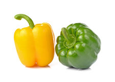 Sweet green and yellow pepper isolated on white background. Royalty Free Stock Photos