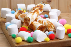 sweet grilled marshmallow on a skewer Royalty Free Stock Photo